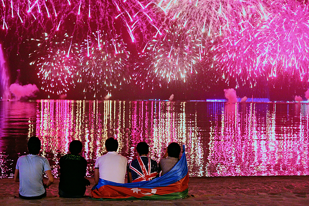 Music fans watch the opening ceremony fireworks of the Eurovision song contest in Baku. (Sitara Ibrahimova)