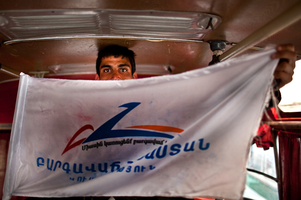 A supporter of the Prosperous Armenia Party attends a political rally during the parliamentary elections. (Anahit Hayrapetyan)