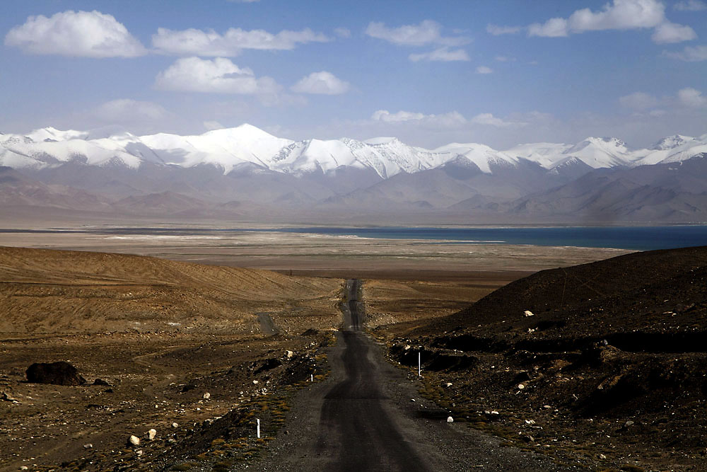 The Pamir Highway heads south into Karakol, Tajikistan. (Keith Mellnick)
