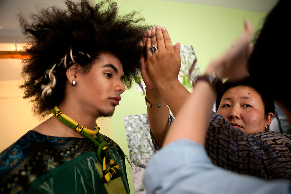 A stylist prepares a model for Kyrgyzstan's ProFashion television show in Bishkek. (David Trilling)