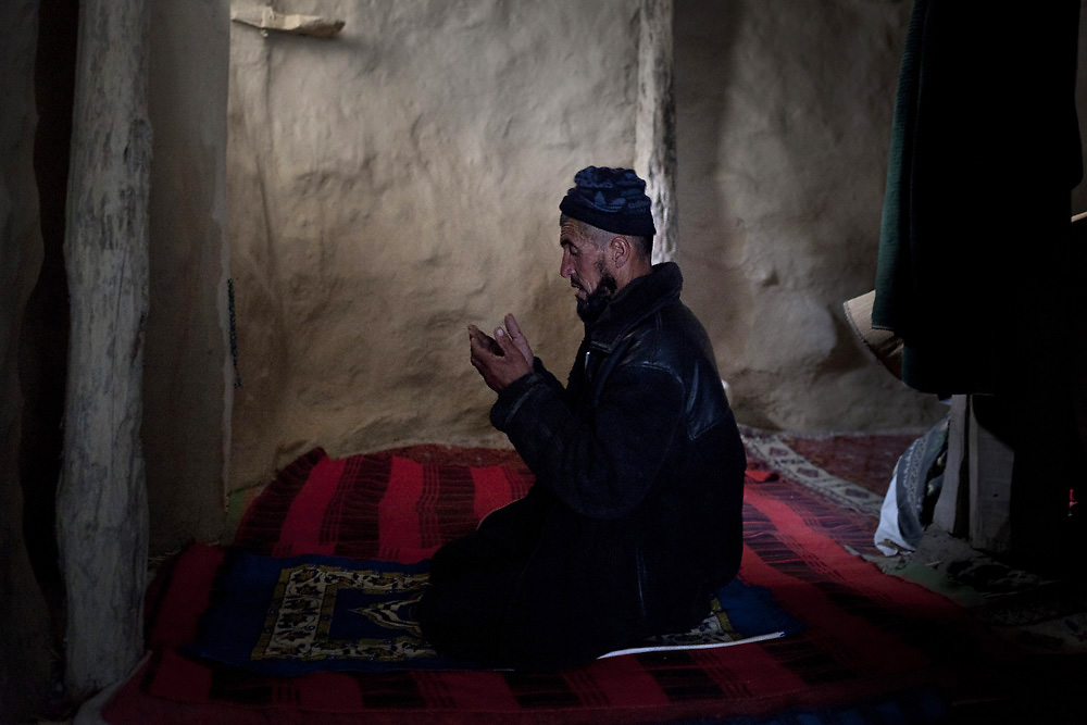 A village mullah with ethnic Yagnobis in Bedev, Tajikistan, prays in the village mosque. (Theodore Kaye)