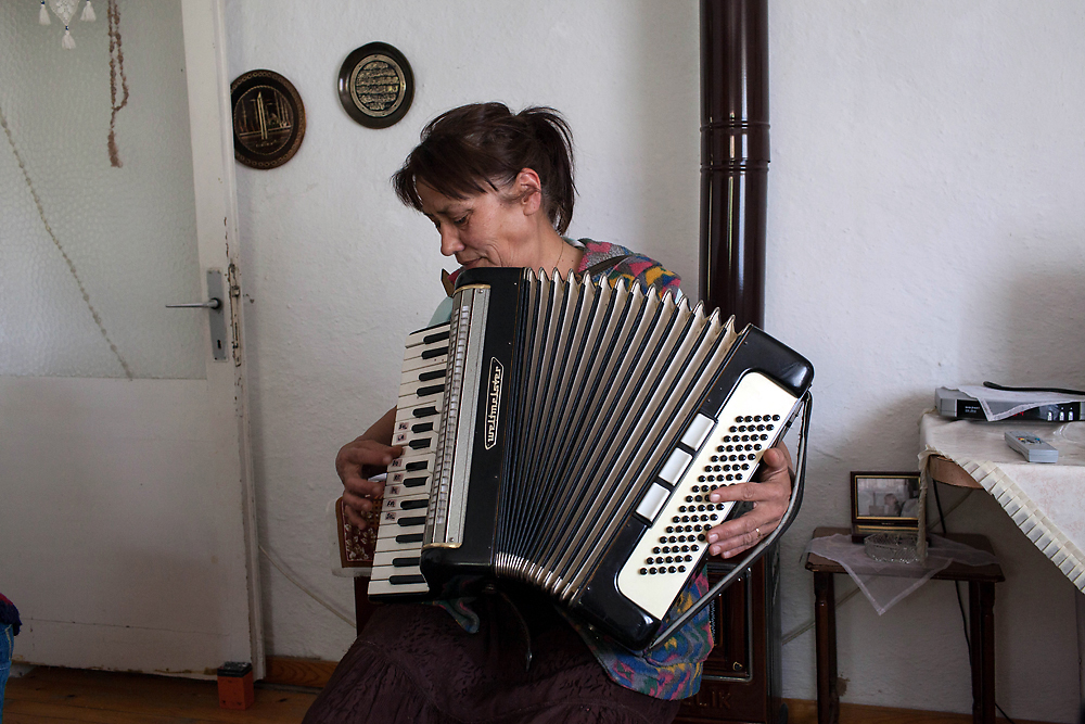Ravza Melle, an ethnic Tatar, plays traditional music on an accordion in Turkey. (Justin Vela)