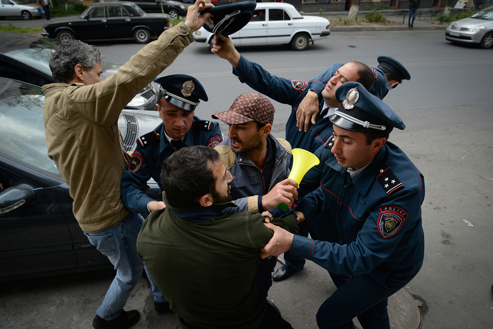 Police detained over 200 hundred demonstrators by early evening, sometimes using force. (Garegin Alexanyan/4Plus)