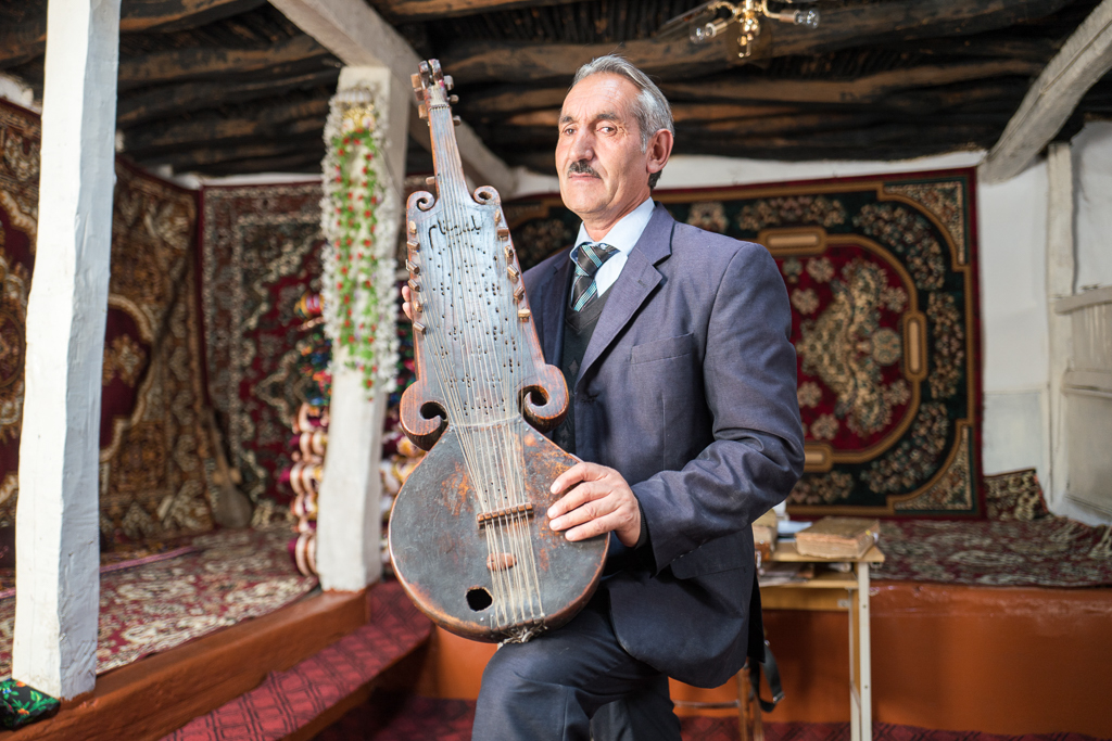 The director of a primary school near Ishkashim holds a type of rubab