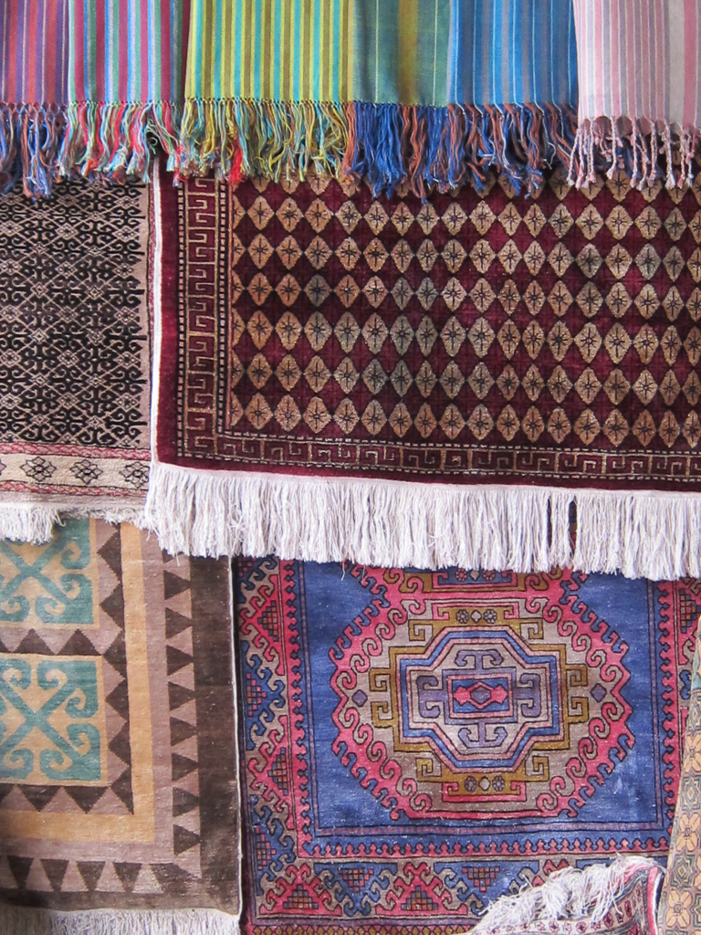 Finished carpets are on sale at the Yodgorlik silk factory.