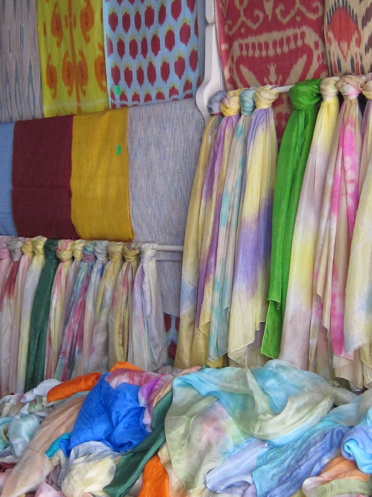Patterns of colored silk fabric available at the Kumtepa market range from psychedelic to two-toned.
