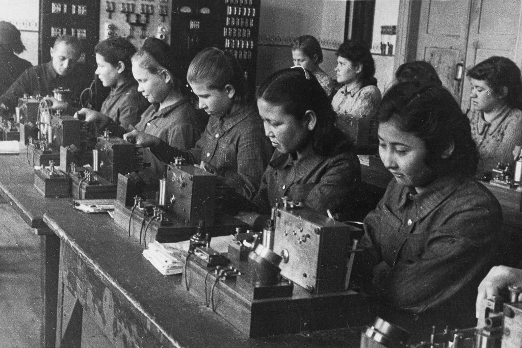 Young trainees in the telegraph operators' class at the Communications Trade School