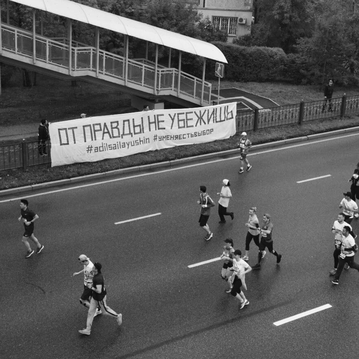 "activists unfurled a banner bearing the words: ""You cannot run from the truth"" at a marathon in Kazakhstan"