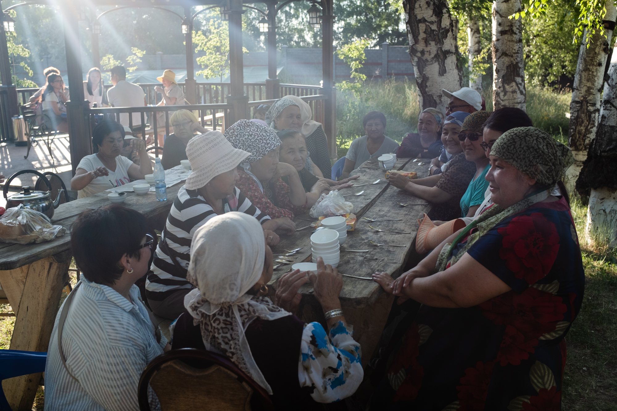 older people pulled up chairs to discuss politics and prepared snacks and tea for new arrivals