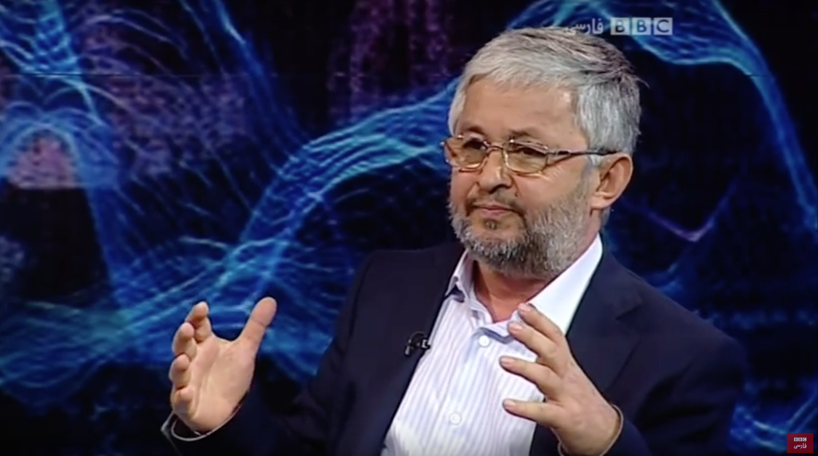 Dodojon Atovulloyev seen during a 2013 interview with the BBC's Persian service.