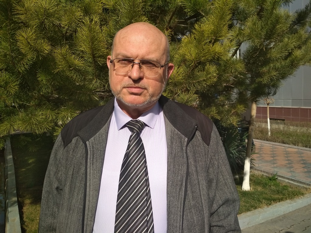 Sergei Mayorov, the lawyer acting for Bobomurod Abdullayev, posing for a photograph outside Tashkent city court on March 7. (Photo: Eurasianet).