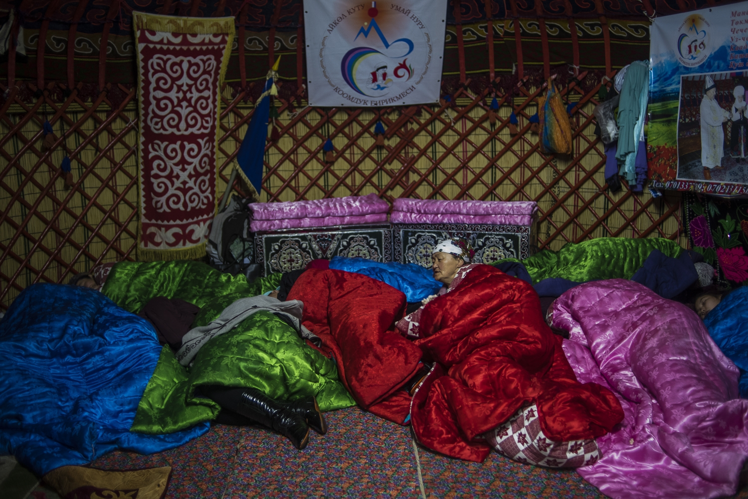 people sleeping in yurts