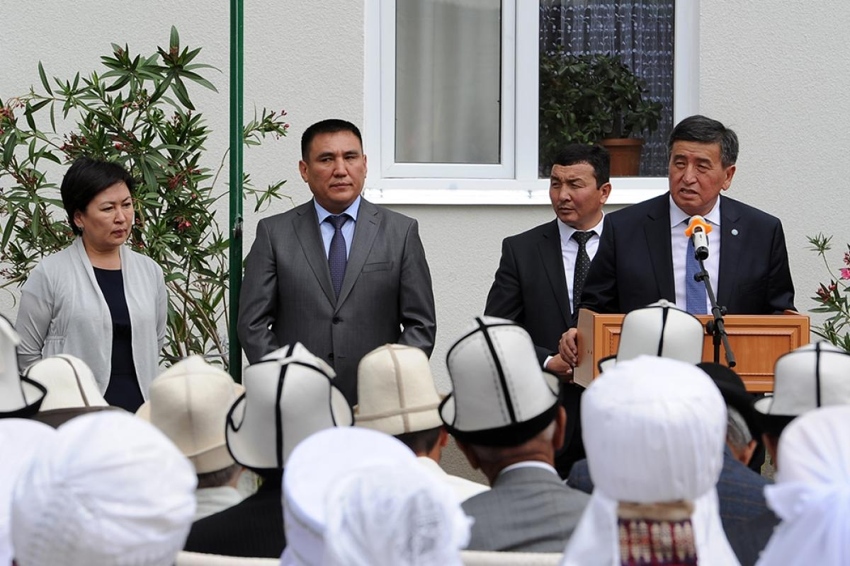 Sooronbai Jeenbekov addresses an audience at the opening of a kindergarten in the southern Osh province on June 12, 2017.
