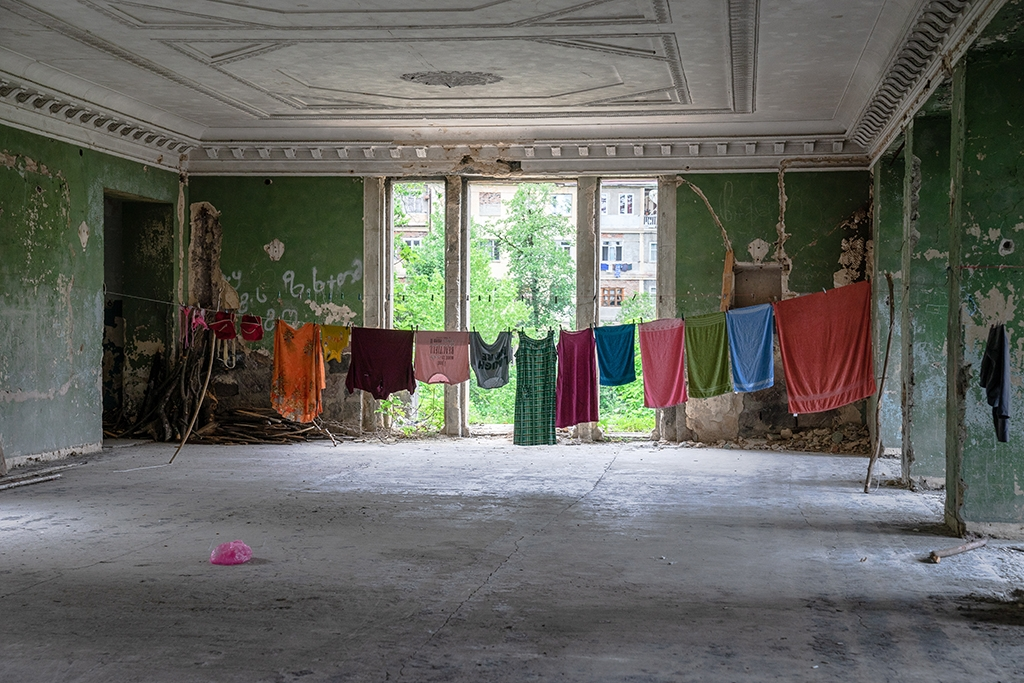 Laundry drying in the Railwayman Sanatorium, a Soviet hotel that has been home to IDPs for decades.