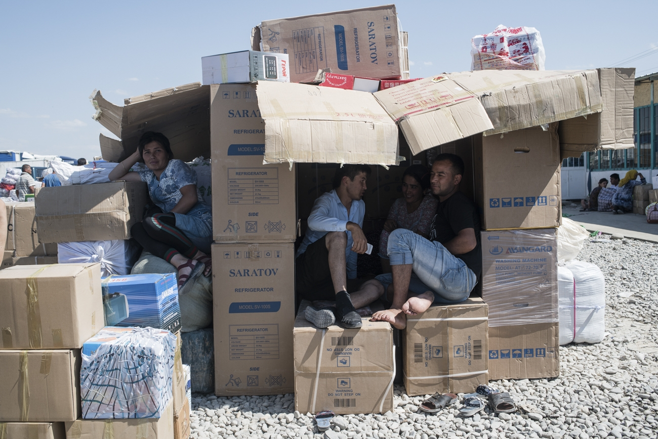Uzbek citizens build themselves shelter from the sun