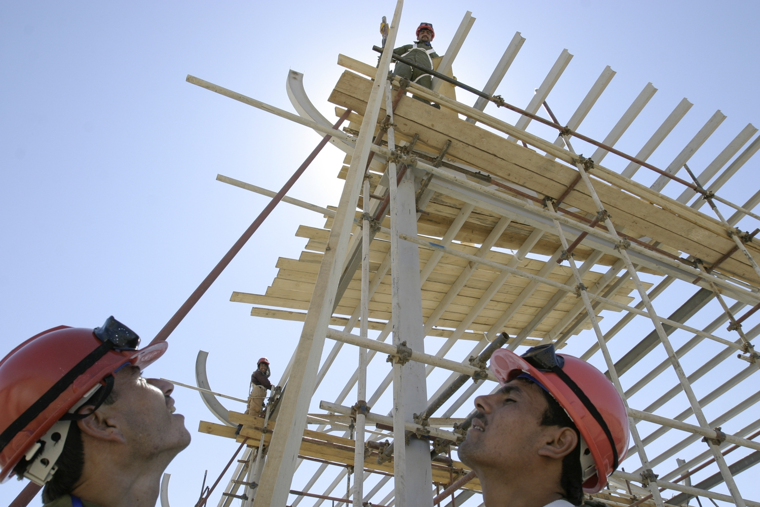 Construction workers build a customs house on the Afghan side. (David Trilling for EurasiaNet)