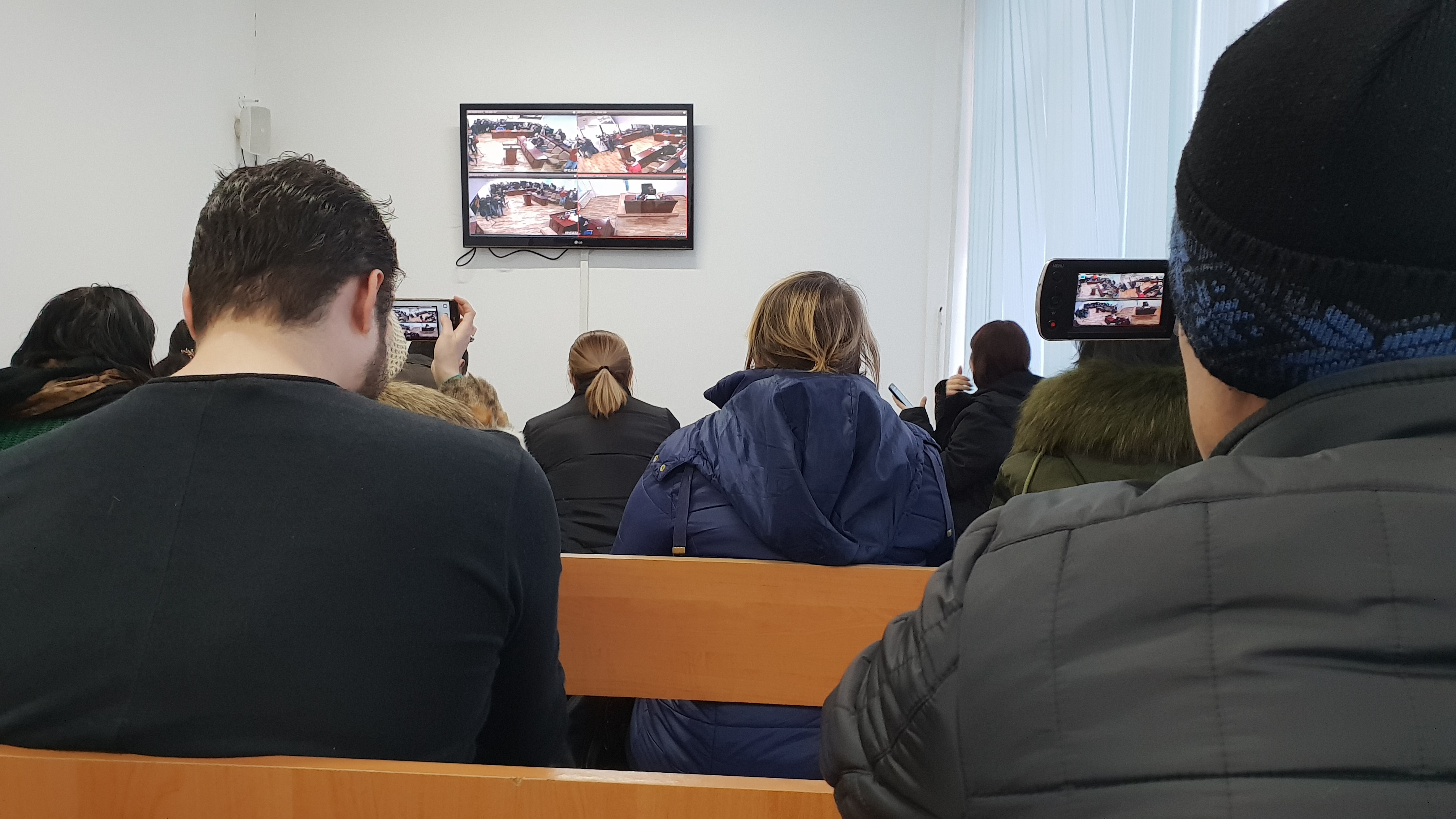 Reporters at the Almaty courthouse watching the verdict via a video link-up. (Photo: Almaz Kumenov/Eurasianet)