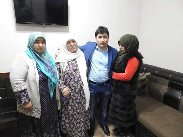 Gadoyev posing for a photo with his family after his return to Tajikistan. (Photo: Tajikistan Interior Ministry)