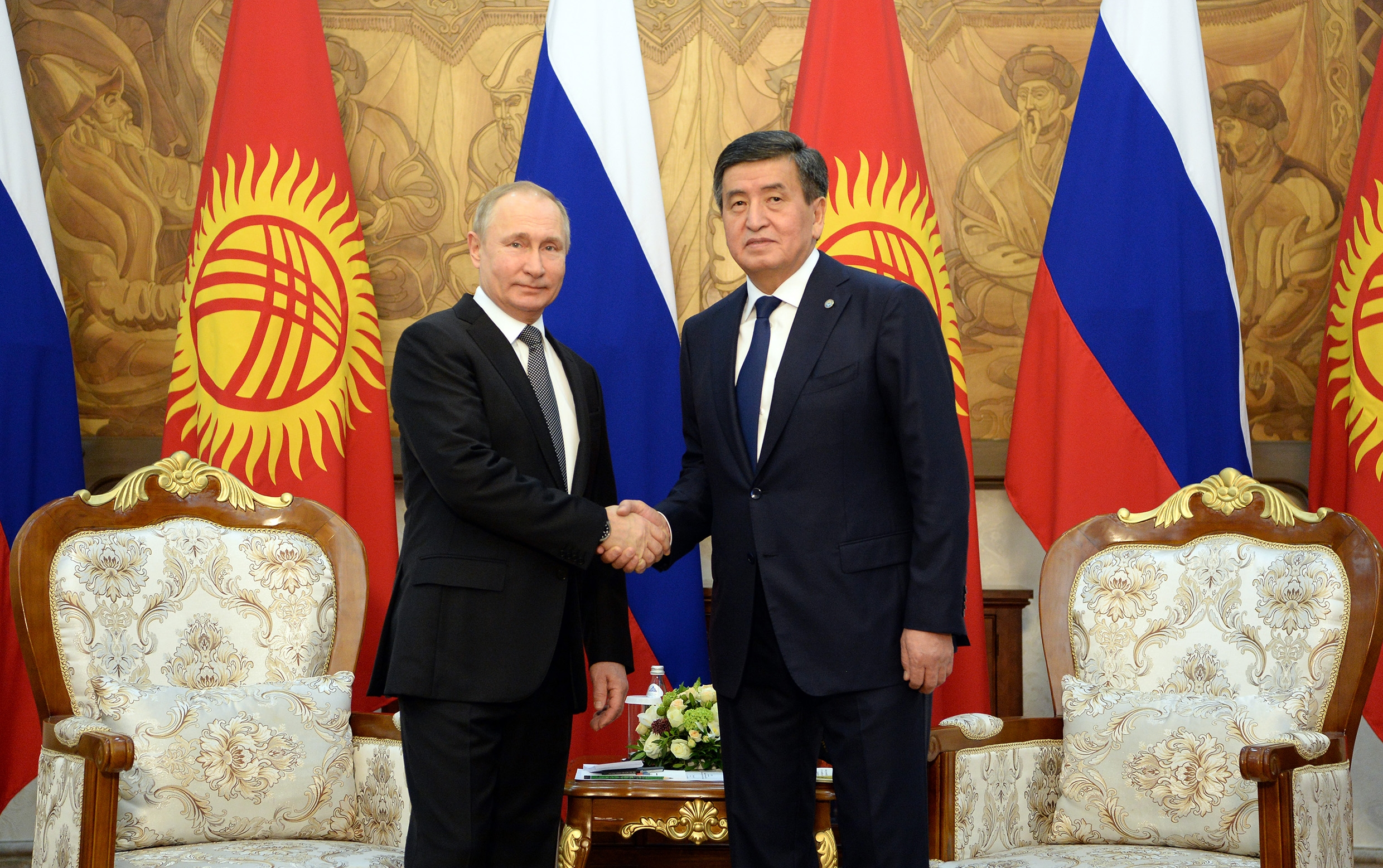 It's a deal: Putin and Jeenbekov shaking on it in Bishkek on March 28. (Photo: Kyrgyz presidential administration)