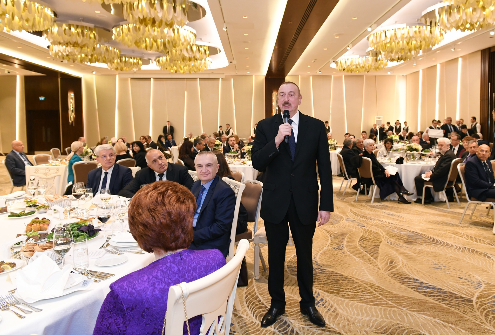 Ilham Aliyev gives a speech in a gold and crystal room