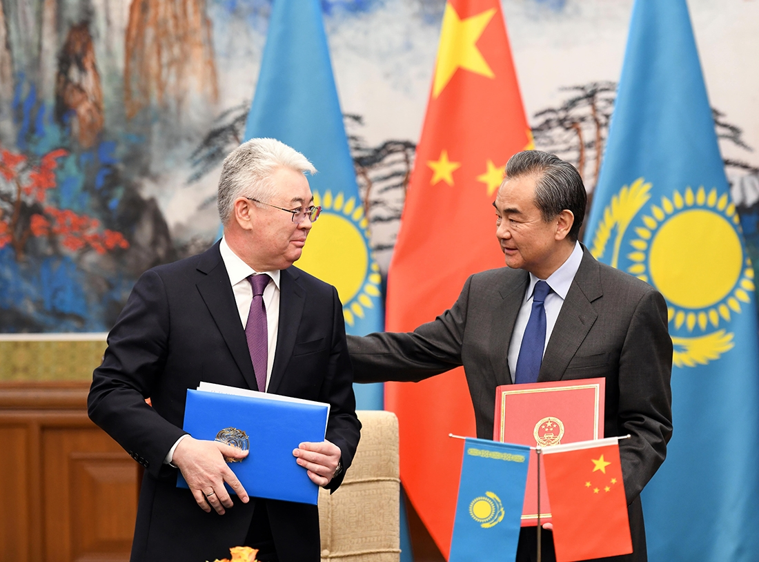 Chinese Foreign Minister Wang Yi hosts/consoles his Kazakh counterpart, Beibut Atamkulov, in Beijing on March 28. (Kazakh Foreign Ministry)