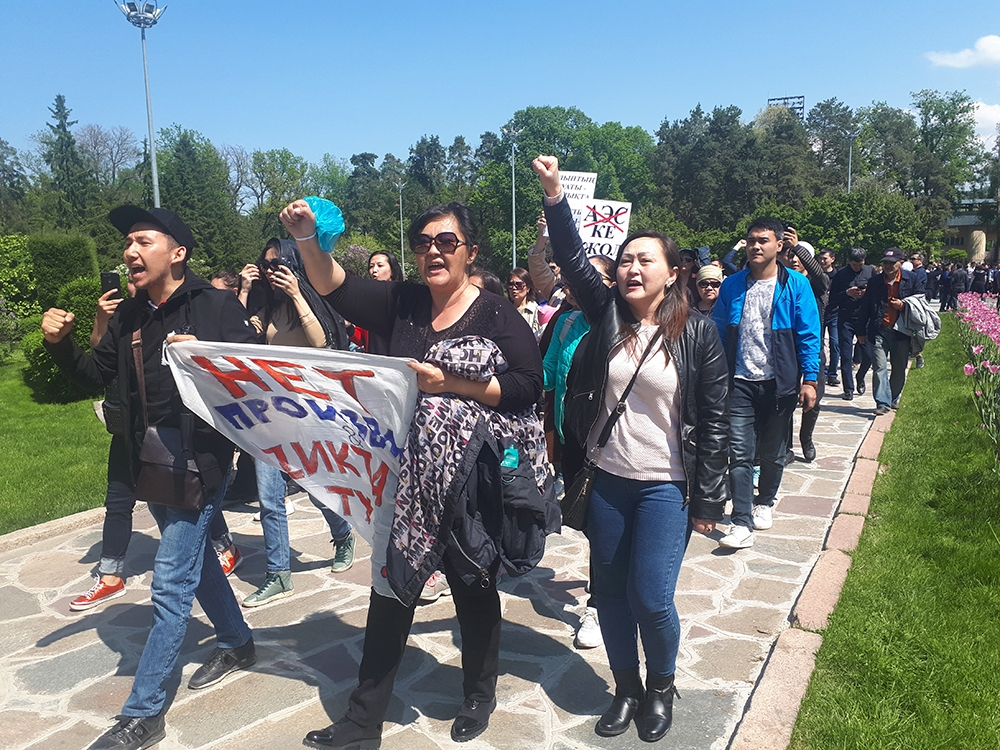 Protestors march through Almaty's Gorky Park