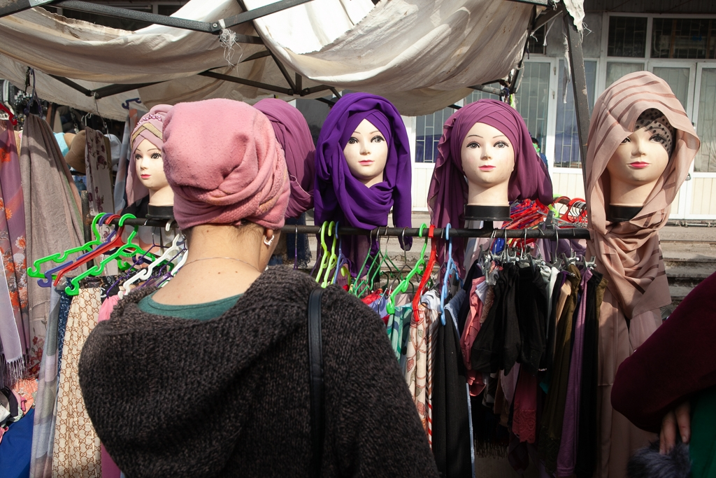 A woman examines headscarves for sale at Tashkent's Chorsu Bazaar. (David Trilling)