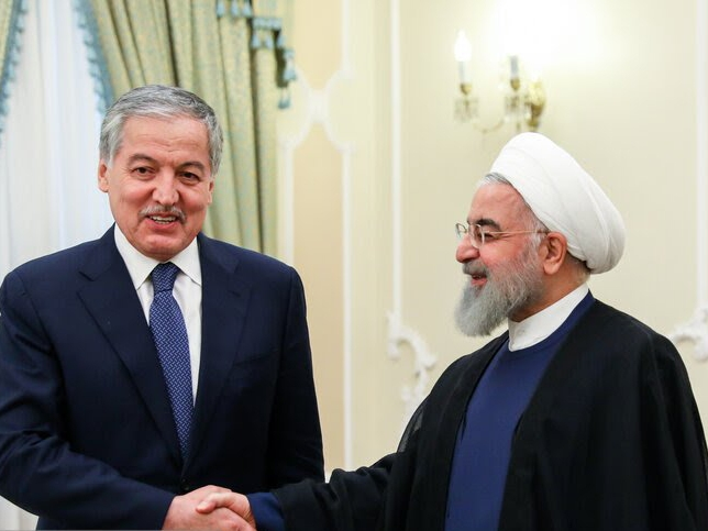 Shake on it: Muhriddin meeting with Rouhani during his visit to Tehran earlier this month. (Photo: Tajik Foreign Ministry)