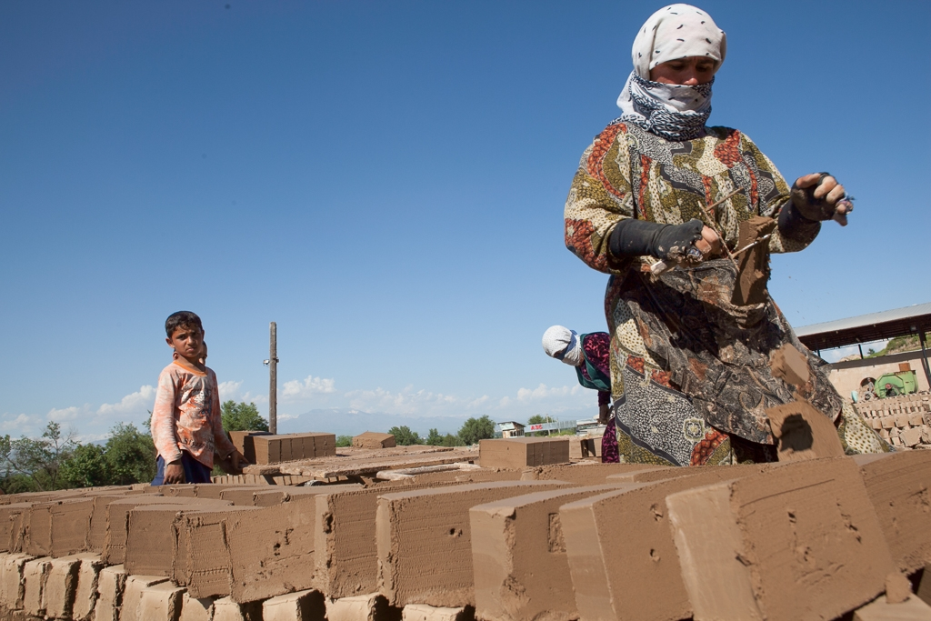 Women making bricks outside Dushanbe (David Trilling)