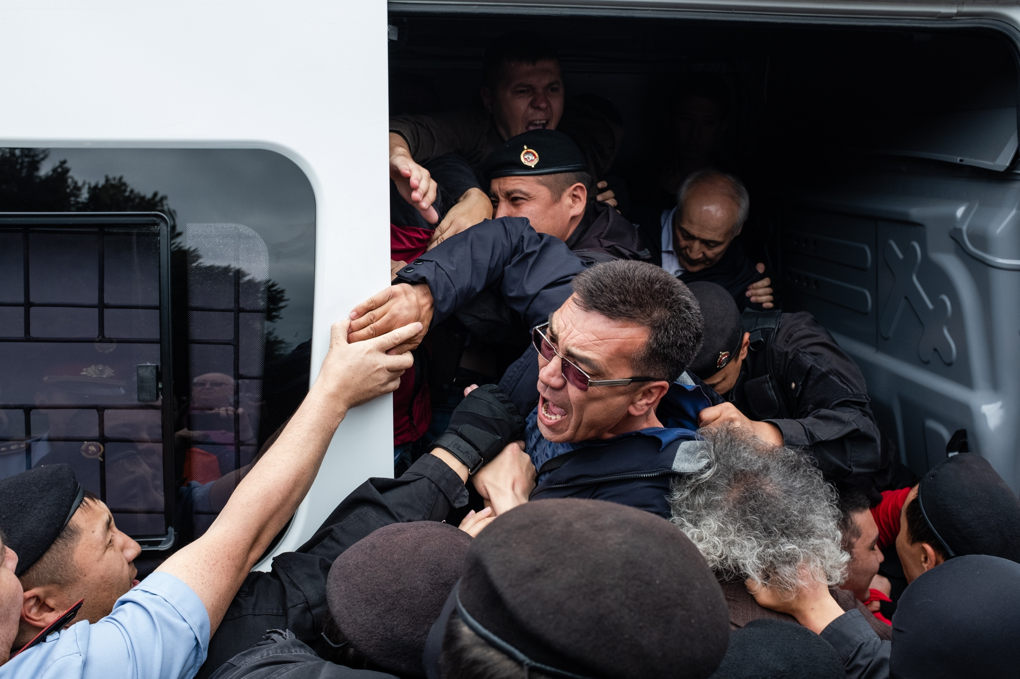 I scream: Protester being shoved into a police van in Almaty on June 9. (Photo: Danil Usmanov)
