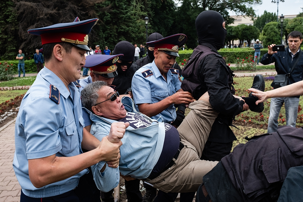 A demonstrator being carried away by police in Almaty. (Photo: Danil Usmanov)
