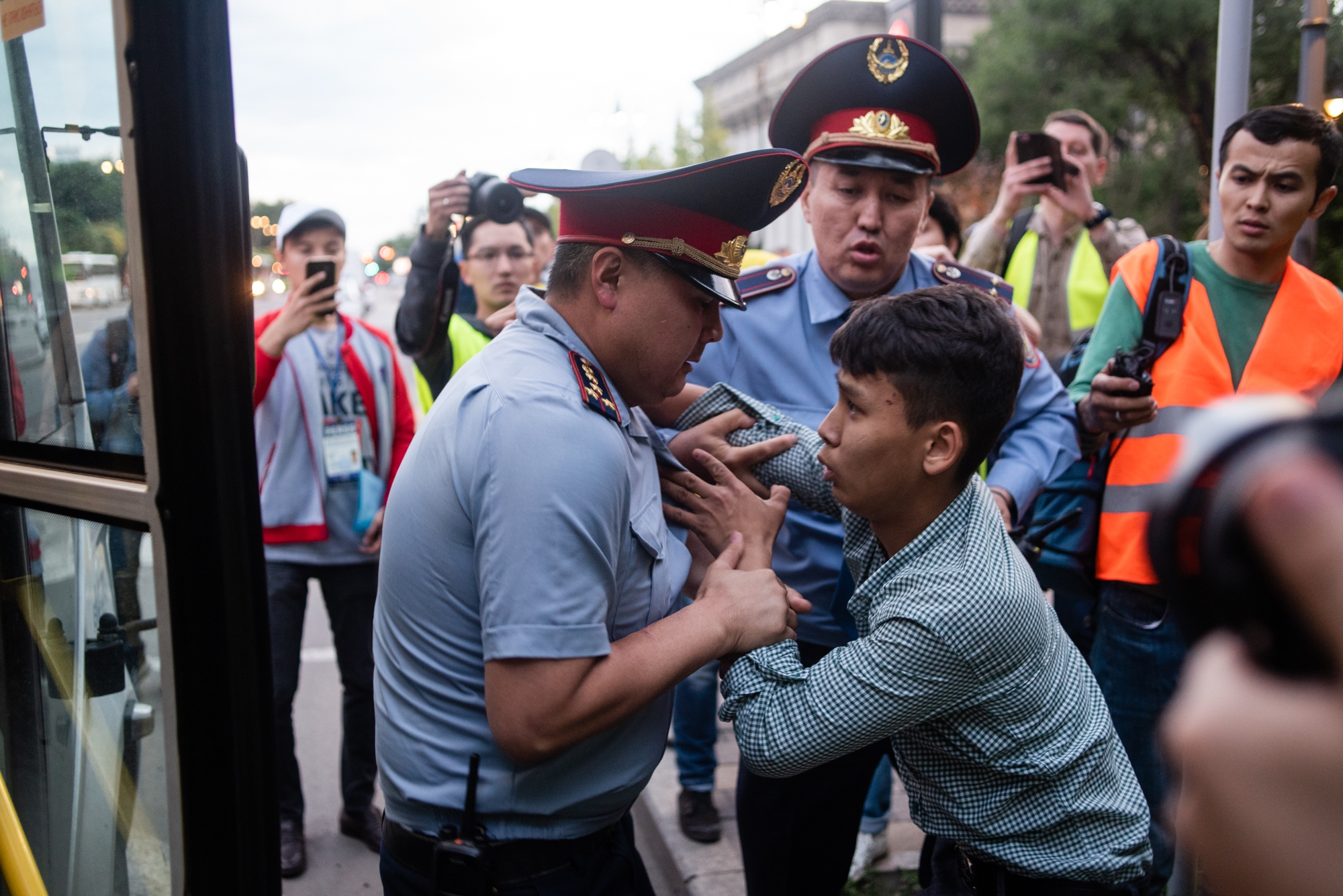 Now you see it: A policeman detaining a young man during an abortive demonstration in Almaty on June 12. (Photo: Danil Usmanov)