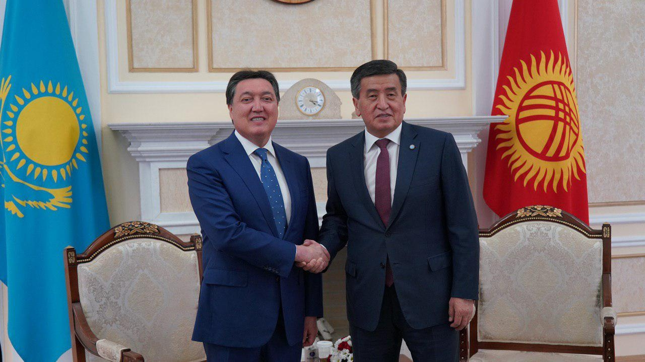 "Don't say ""ban on cheese""!: Kazakhstan's Prime Minister Askar Mamin, left, meeting with Kyrgyz President Sooronbai Jeenbekov in May. (Photo: Kazakhstan government handout)"