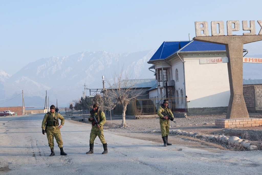 Tajik border guards block the de facto entrance to the Tajik exclave of Vorukh.