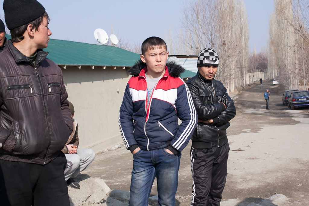 Young Tajik men in a village they call Somonion say Kyrgyz border guards harass them.