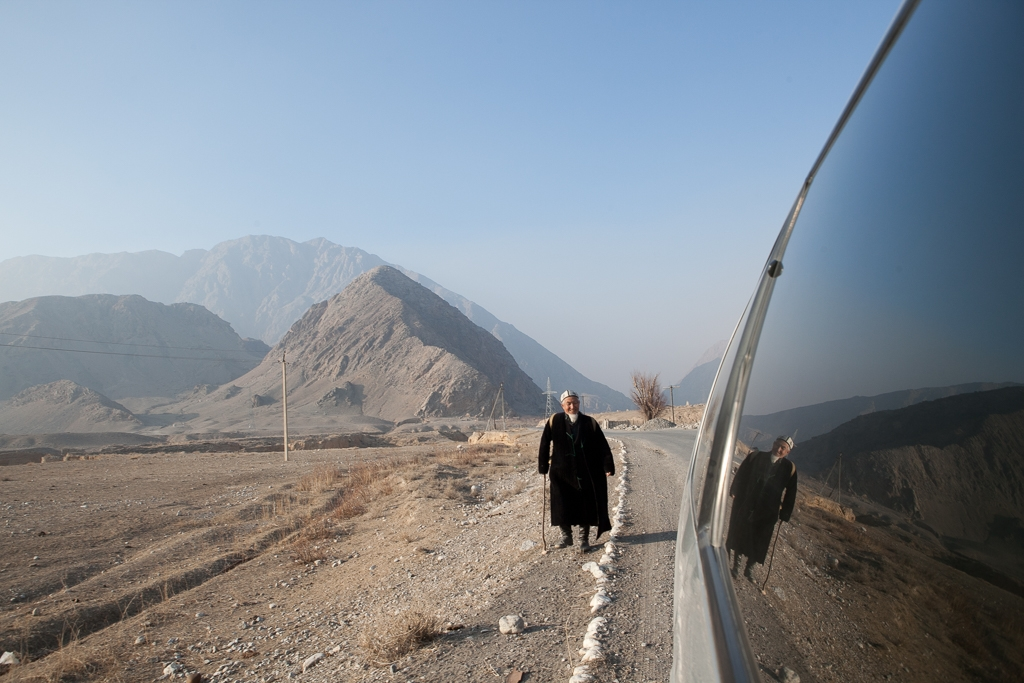 A man walks along a road passing through disputed territory that connects Kyrgyzstan and Tajikistan.