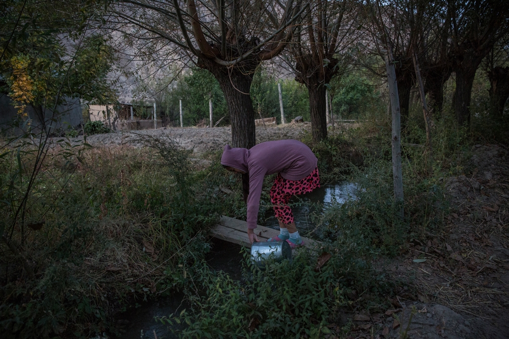 Nurjamal Alimbekova, 16, lives in the village of Lyaily where nearly all 300 families use water from an irrigation canal.