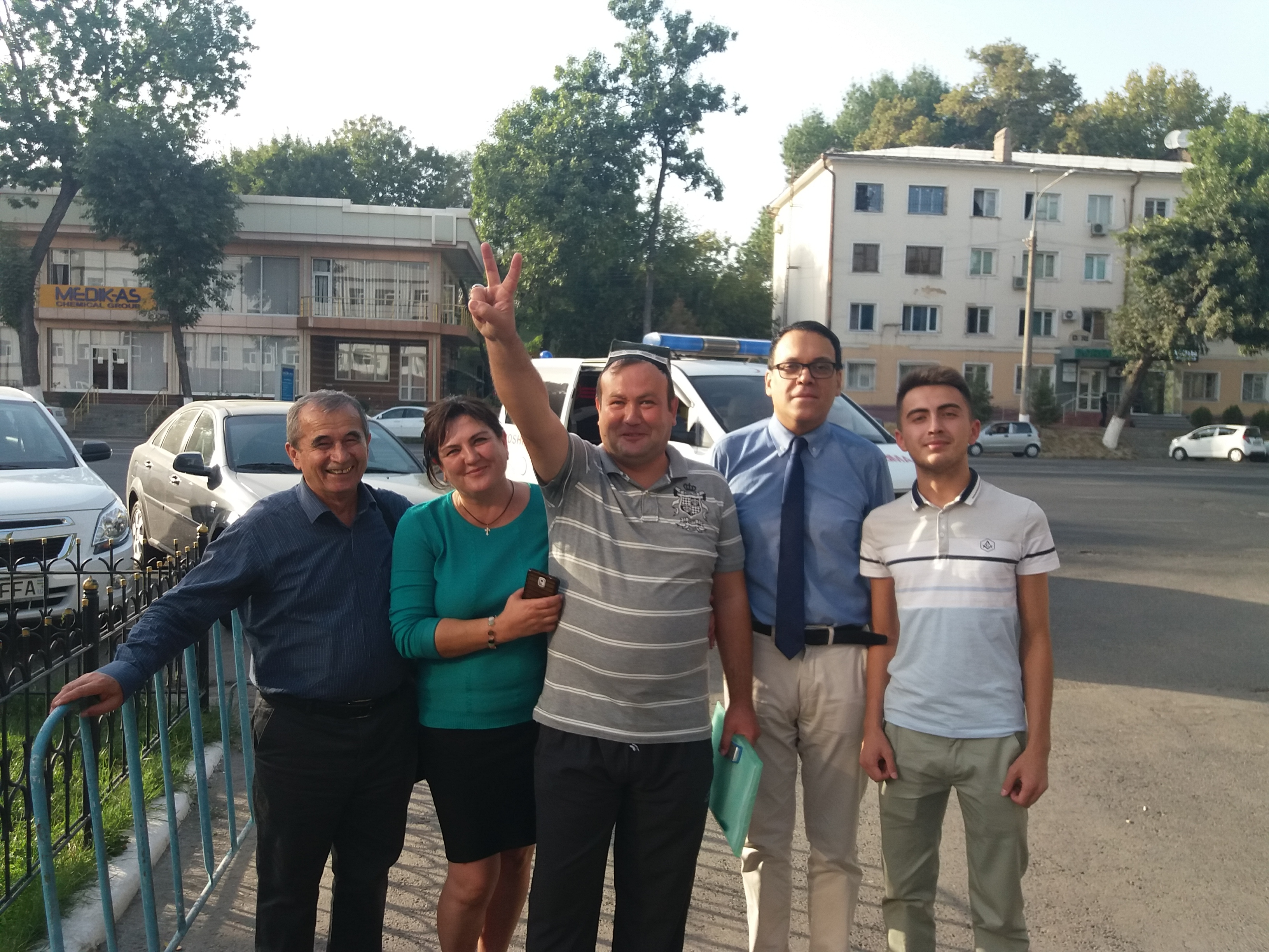 Kubatin, center, posing after his release with his wife, Klara Sakharova, activists Azgam Turgunov, left, and Anvar Nazirov, second right, and Kubatin's student, Andrei Otabek. (Photo: Courtesy photo)