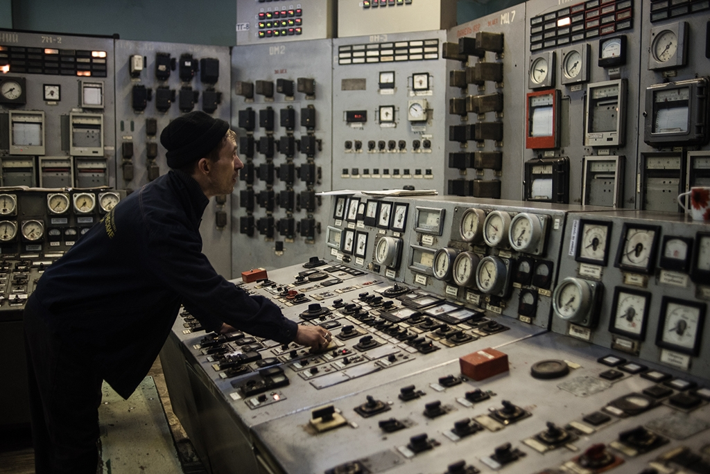 Technician in a control room at the Bishkek Thermal Power Station, which was refitted with Chinese money. (Photo by Danil Usmanov)