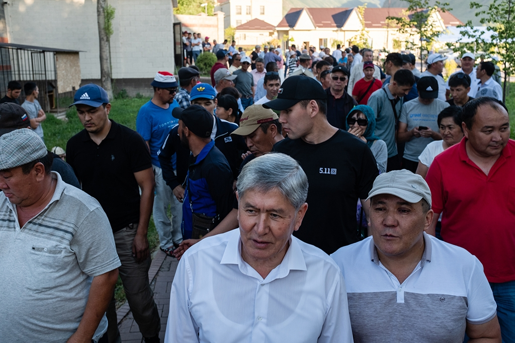 Atambayev, center, with his supporters at this country residence in June. (Photo: Danil Usmanov)