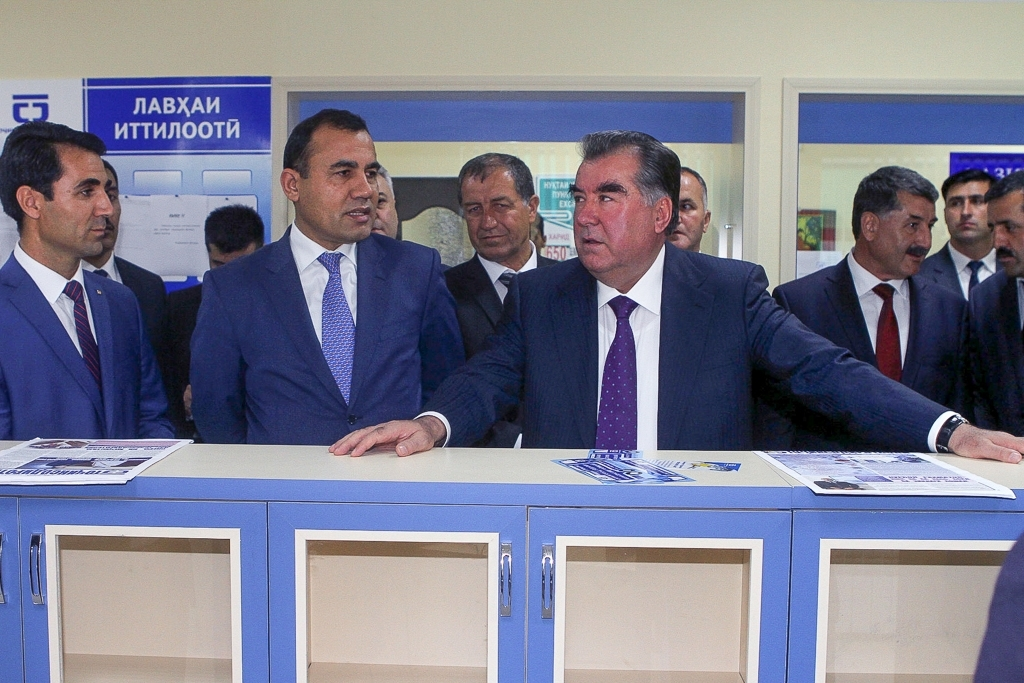 Me no worry: Rahmon hanging out with executives from Tojiksodirotbank. (Photo: Presidential administration)