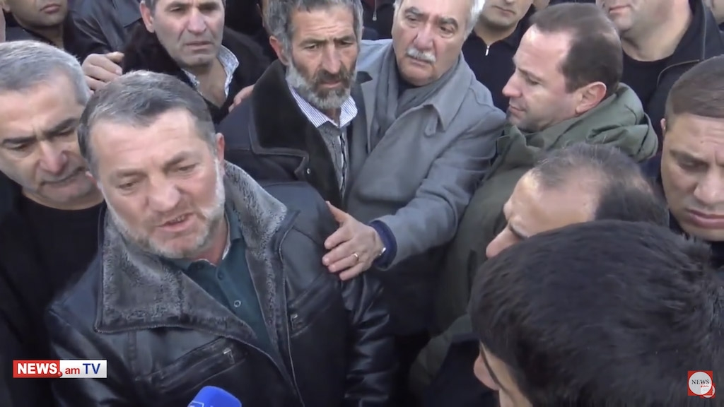 Screenshot of Armenian Defense Minister Davit Toniyan, upper right, in a crowd of protesters disputing the government's account of a soldier's death.