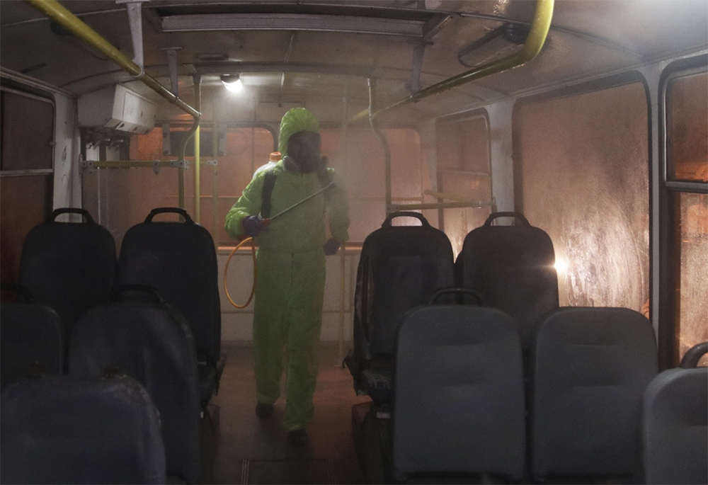A worker disinfects a city bus in Sukhumi, the de facto capital of Abkhazia. (sukhumcity.ru)