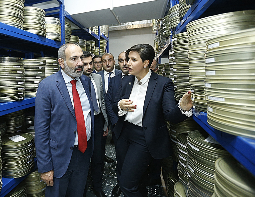 Pashinyan with Public TV director Margarita Grigoryan during a visit to the state broadcaster in September. (primeminister.am)