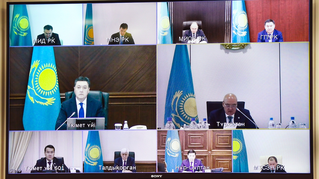 Screen and shout: Prime Minister Askar Mamin, center left, presiding over a remote Cabinet meeting on April 2. (Photo: Government website)