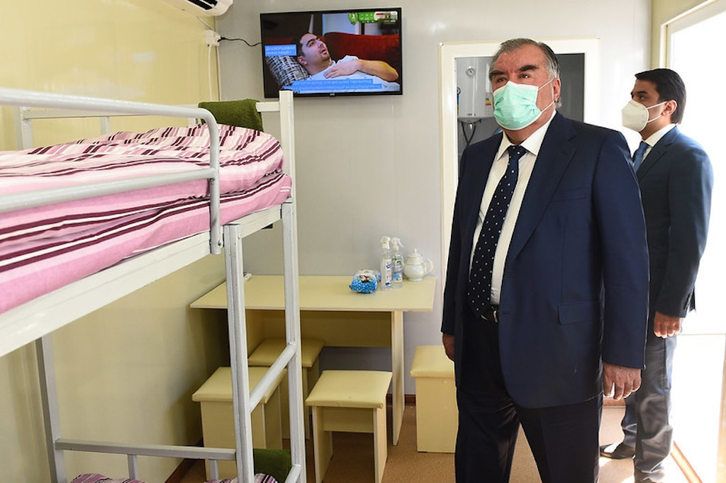 Rahmon tours a treatment facility with his son, Rustam Emomali, seen right. (Photo: Presidential administration press service)
