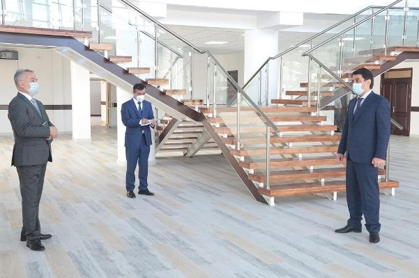 Where the son don't shine: Rustam Emomali, right, examining premises of a new hospital. (Photo: Mayor's office)