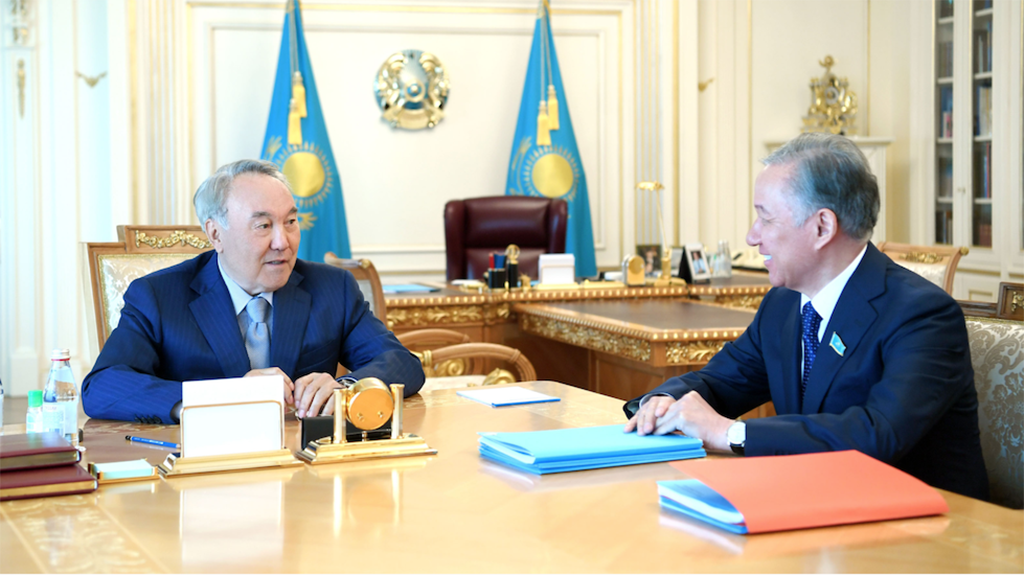 Nazarbayev, left, meeting with parliament speaker Nigmatulin in May. Both men have now tested positive for COVID-19. (Photo: Elbasy.kz)