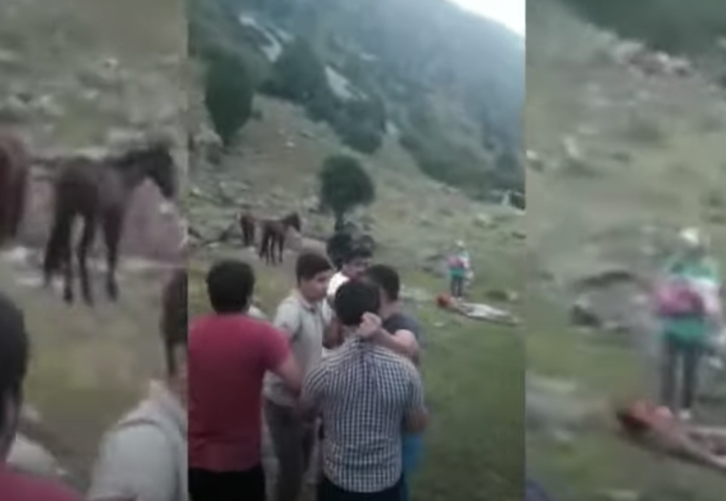 A screenshot of the footage showing the assault on the Pakistani students.