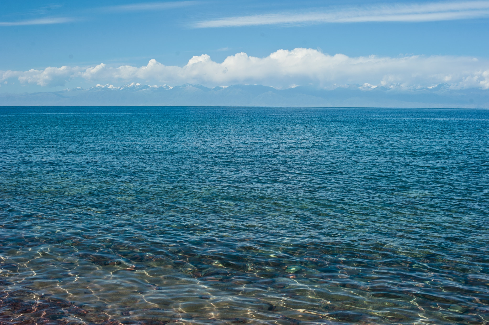 Not sick? Cool: A view of Issyk-Kul that Kazahk tourists are being denied, for now. (Photo: Matthias Buehler/Flickr)